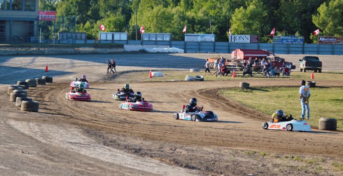 Brighton Speedway Kart Klub drivers race in to turn three during June 30 action. (Carley Davis photo).