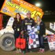 17-year-old Dylan Westbrook in victory lane with representatives from Rock 107 following his third straight SOS win at Brighton. (Rod Henderson photo).