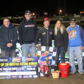 Erick Rudolph in victory lane with his team following his 358 Modified win. (Rod Henderson photo).